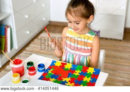 World Autism Awareness Day . The Child Draws Bright Colorful Puzzles With Gouache.  A Creative Child
