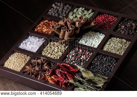 Close Up Of A Compartment Box Filled With A Variety Of Whole Dry .