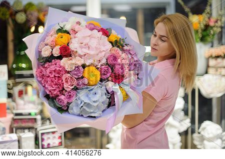 Large Gorgeous Bouquet Of Hydrangea Roses And Ranunculus Flowers In Hands Of Young Florist Woman