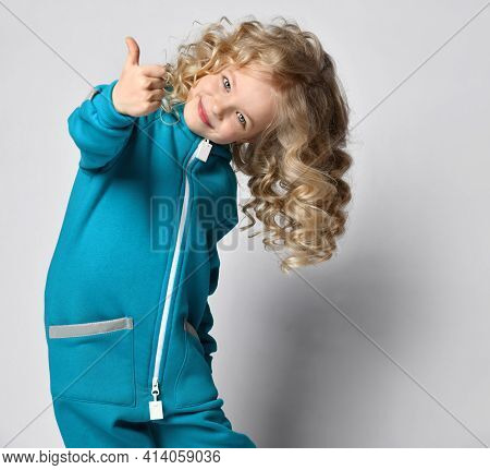 Smiling Happy Girl In Warm Fashion Jumpsuit Trendy Sportswear Showing Thumbs Up Approve Like Agree G