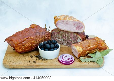 Assorted Meat Sausages, Delicacies On A Wooden Board On A White Background