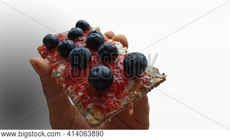 Healthy Delicious Breakfast Concept Of Crunchy Fiber Bread With Peanut Butter, Jam And Bunch Of Blue