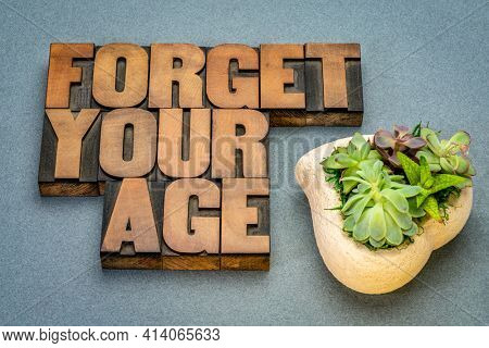 Forget your age inspirational advice in vintage letterpress wood type, lifestyle, aging and personal development concept