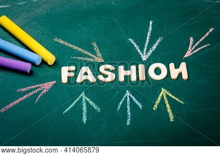 Fashion. Colored Pieces Of Chalk On A Green Chalk Board