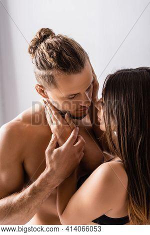 Brunette Woman Kissing Seductive Man At Home.