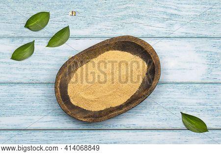 Lepidium Meyenii - Maca Powder In The Wooden Bowl