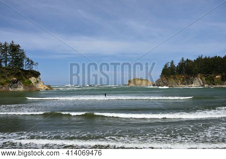 Paddle Boarder Waiting For A Wave In Sunset Bay State Park, Oregon