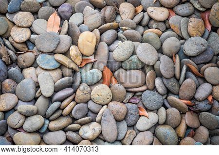 Top View Photo Of River Gravel In The Sun During The Day With Vignette Effect.