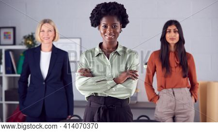 Portrait Of Female Multi-Racial Business Team Standing In Office