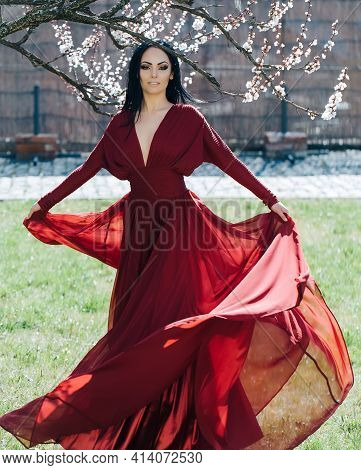 Beauty Romantic Woman In Flowers. Sensual Spring Lady On Nature. Romantic Beauty In Fantasy Orchard.