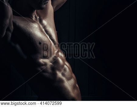 Muscular Young Man With Athletic Bare Body On Black Background. Sexy Gay, Seductive Shirtless, Torso