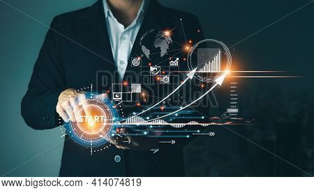 Concept Of Startup Business To Be Successful, Businessman Touch Tablet Screens, Business Icons And N