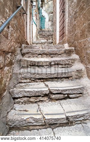 Ancient Stone Steps Leading Steeply Up An Old Narrow Alleyway In Kotor,montenegro.