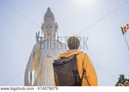 Male Tourist On The Background Of Majestic View Of The Lady Buddha Statue The Bodhisattva Of Mercy,
