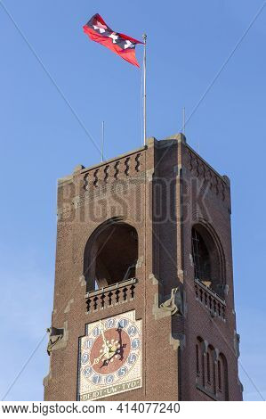 Amsterdam, Netherlands - July 02, 2018: View Of The Tower Of The Berlage Exchange Building With Flag