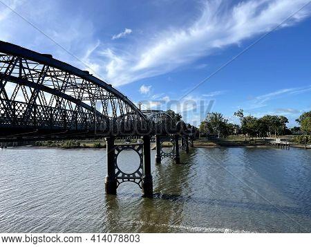 View Of The Burnett Bridge, A Metal Truss Bridge Spanning The Burnett River Built In 1900, In Bundab