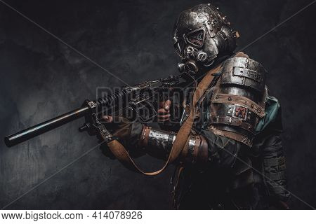 Stalker With Custom Armour And Gun Poses In Dark Background