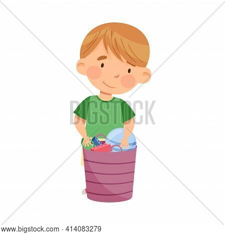 Cute Little Boy Standing Near Basket With Different Toys In Kindergarden Vector Illustration