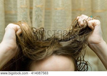 Mess, Problem Hair. Woman Holding Tangled Hair In Her Hands.