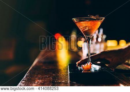 Fresh Glass Of Tropical Cocktail With Juice At Bar Counter Background. Cocktail Glasses With Ice And