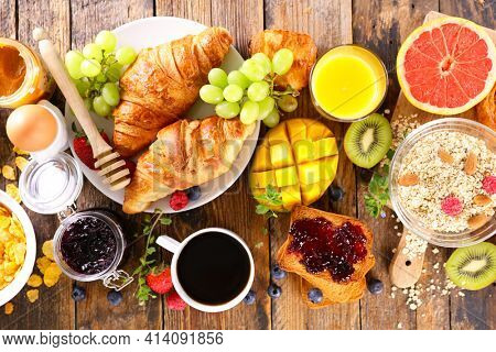 continental breakfast- coffee cup,  croissant,  cereal and fruit