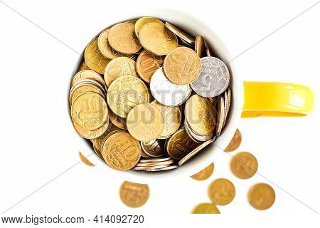 Metal Coins In A Ceramic Mug Isolated On A White Background. Keeping Personal Savings. Financial Cri
