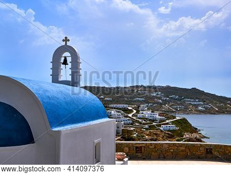 Traditional Greek Orthodox Church, Blue Dome, Bell Tower Overlooking Typical Greek Island Landscape