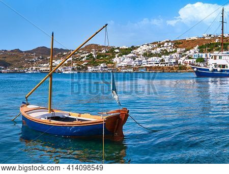 Beautiful Summer Day In Typical Greek Island. Fishing Boats, Whitewashed House. Small Blue Boat In F