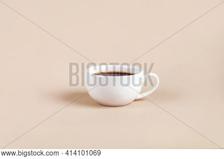 White Cup With Black Coffee Espresso On Color Background. Minimalism, Copy Space For Text