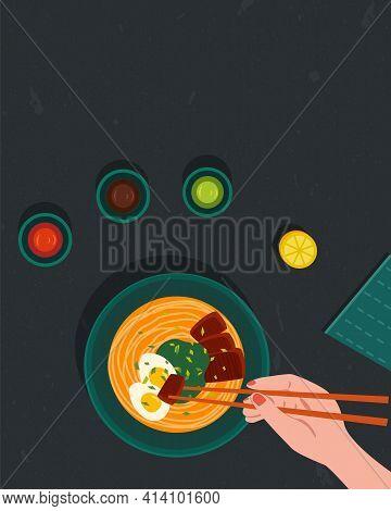 Ramen Japanese Noodle Soup. Top View. Girl Eating Ramen Holding Chopsticks. Hand Holding Chopsticks.