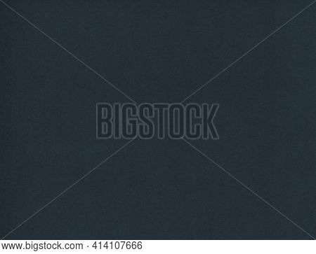 Horizontal Front View High Resolution Closeup Detail Of Empty Dark Blue Paper Background Texture