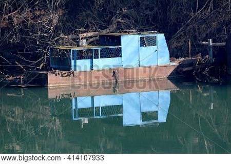 Vintage Retro Old Partially Rusted River Barge Converted In Creepy Small Metal River Boat Enclosed W