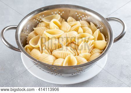 Cooked Pasta In A Sieve. Pasta For Making Fetapasta. Home Cooking Concept.
