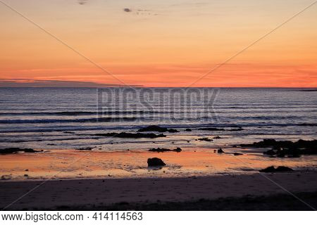 Beautiful Orange Sunset At A Beach In France