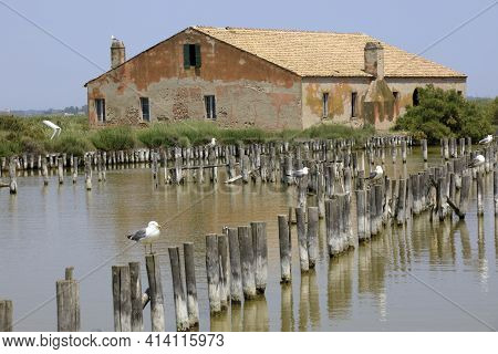 Po River (fe),  Italy - April 30, 2017: A Fishing Preserve Near An Old Fisherman's House On Po River