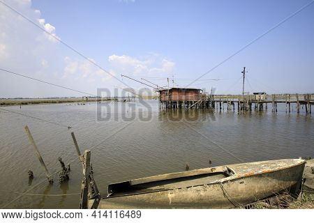 Po River (fe),  Italy - April 30, 2017: A Fisherman\'s Boat On A Side Of Po River, Delta Regional Pa