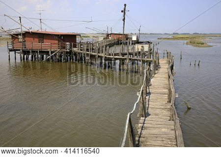 Po River (fe),  Italy - April 30, 2017: The Pier With An Old Fisherman\'s House On Po River, Delta R