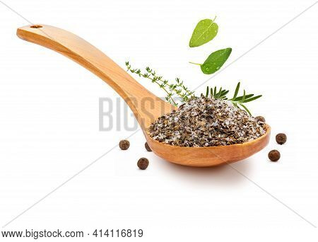 Fine And White Salt With Fine Herbs, With Various Spices (rosemary, Oregano And Black Pepper) In A W