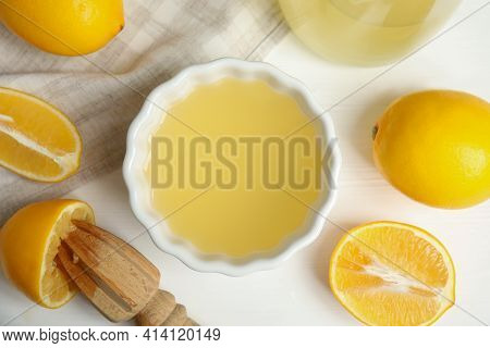 Freshly Squeezed Lemon Juice On White Wooden Table, Flat Lay