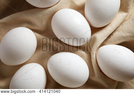 Close-up of eggs on a dishcloth.
