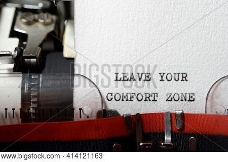 Leave your comfort zone phrase written with a typewriter.