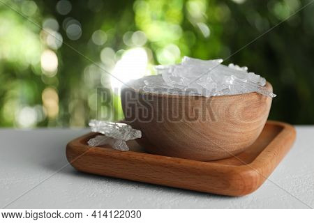 Menthol Crystals On White Table Against Blurred Background