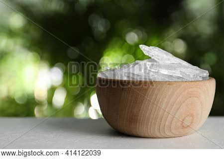 Menthol Crystals In Wooden Bowl On White Table Against Blurred Background. Space For Text