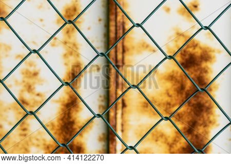 Mesh Pattern On The Background Of A Rusty Iron Wall