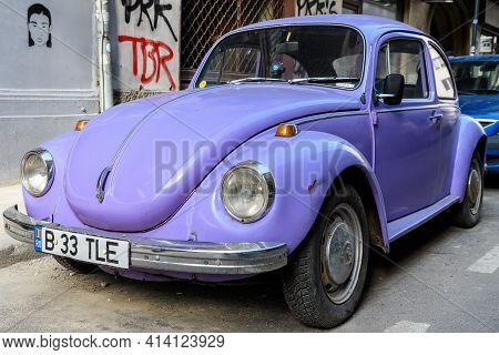 Bucharest, Romania, 9 February 2019 Old Vivid Mauve Volkswagen Beetle Car Parked A Street In A Sunny