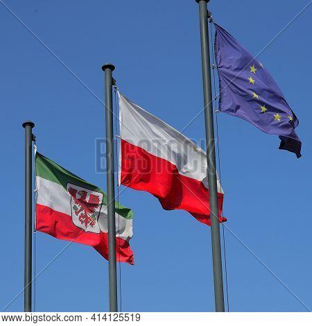 Flags of Gorzów Wielkopolski, Poland and the European Union on the Gorzów boulevard