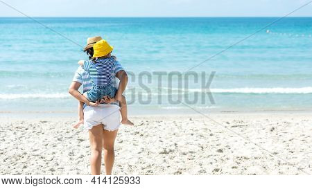 Asia Happy Family Have Fun And Running Relax On The Beach For Leisure And Destination.  Family Peopl
