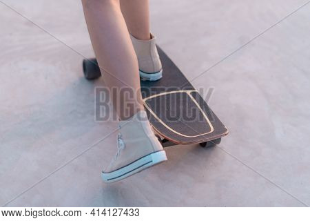 Closeup Asian Woman Playing On Surfskate Or Skate Board In Outdoor Park