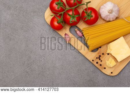 Spaghetti With Ingredients For Cooking Italian Pasta On Grey Background Copy Space Top View