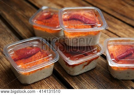 Savoury Spread With Lard In Plastic Containers On Wooden Table. Food Delivery Service